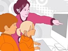Alumnes amb professora davant l'ordinador. Premi TIC Impuls