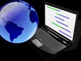 Il·lustració d`un ordinador i un globus terraqüi
