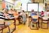 Niños/as sentados en el aula